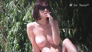 Hot nudist woman captured overwrought a hidden beach camera